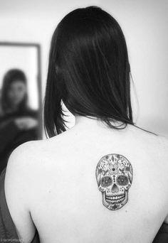 Beautiful skull tattoo , but I'd want it on my lower arm