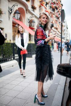 The couture runway might be fashion's grandest stage, but some showgoers are keeping things interesting on the Paris streets this week.