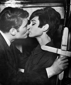 """A scene from """"How to Steal a Million,"""" with Peter O'Toole and Audrey Hepburn. Peter wasn't really into the ladies, and it shows here. ;) Nonetheless, the movie was a lot of fun to watch. What they lacked in on-screen sexual chemistry was made up for with witticisms and charm. :)"""