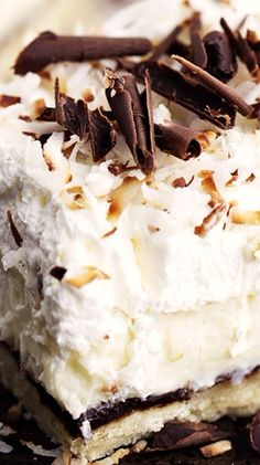 This unforgettable dessert is layered with a shortbread crust, chocolate ganache layer, coconut cream, and topped with whipped cream!