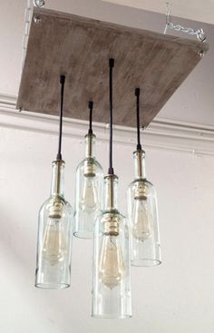 We are obsessed with this unique recycled wine bottle chandelier -- perfect for the kitchen!