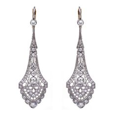 A pair of brilliant cut diamond drop earrings, brilliant cut diamonds mounted in a delicate openworked platinum setting, with shepherd hook fittings