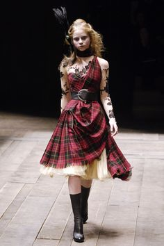 Fall 2006 - McQueen's Fall 2006 collection included references to his earlier Highland Rape collection in the form of the rampant use of tartan. Here, it was rendered more elegant, worn over Victorian crinolines or cut into a Savile Row–worthy suit. See the Complete Fall 2006 Collection