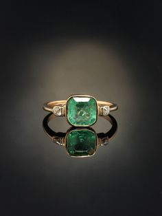 History and meaning  Jewelry fro Georgian era carries such a distinctive air, with the stories they could tell, the changes they have witnessed. Now onto a new life.  Graciousness for Georgian jewelry is represented in this gorgeous natural emerald and diamond trilogy ring bringing with it meaning and drama.  Within the warmth of antique gold a crystal green natural emerald settles in repose amidst the embrace of rubover mounting, kissed by two sparkling romantic old mine cut diamonds on…