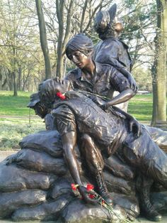 Dedicated on November 11, 1993, as part of the Vietnam Veterans Memorial, the Vietnam Women's Memorial honors the women of the U.S. Armed Forces who took part in the war. The statue was sculpted by Glenna Goodacre and depicts three women coming to the aid of a fallen soldier. It recalls the courage and sacrifice of all the women who served. Planted around the memorial are eight yellowwood trees--a living tribute to the eight servicewomen killed in action while in Vietnam.