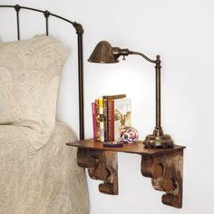 Build a wall shelf to serve as a nightstand and free up space in a small bedroom. Make one out of a vintage roof slate supported by carved wood corbels.