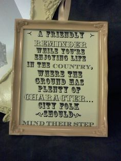 A friendly reminder about walking on country grounds :-) framed in a repainted vintage frame and hung by ribbon on a wrought iron yard stake.