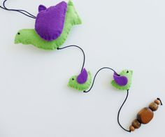 I love creating this kind of children's play and I do so with pleasure and affection. The pieces are created in a smoke free environment.  This mobile is made with green and purple felt and wooden beads, yarn is waxed cotton and the filling is hypoallergenic used in dolls and pillows.  Each mobile includes 3 birds and 2 available.  Perfect for decorating your baby's room and crib or a gift for baby shower.  Total length - approx. 53 cm