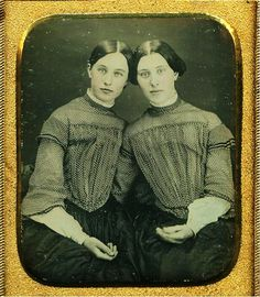 19th c. portrait of two ladies, possibly sisters, wearing identical clothing.