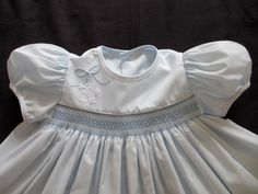 Baby blue dress with Shadow Embroidery, love the simple smocking....use this idea on a simple church dress. Different sleeves - tween look.... look at women's fashion for the sleeves