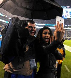 The rain doesn't dampen Jordin Sparks', right, mood as she poses for a photograph with Mike Solarte, sports director and sports anchor for Time Warner Cable News in Charlotte, NC following her singing the National Anthem on Monday, November 2, 2015 at Bank of America Stadium in Charlotte, NC. Sparks sang prior to the Carolina Panthers vs Indianapolis Colts game.