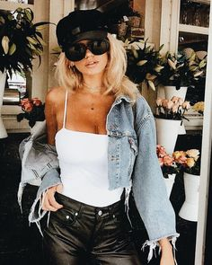 Denim jacket over white cami and black leather pants.
