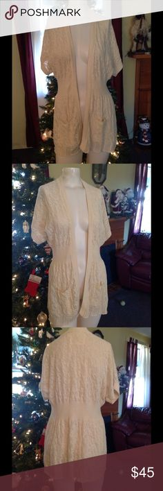 Angel of the North Hangs Open Crochet Sweater S Very pretty Anthro sweater. Cream crochet pattern. Hangs open - made of cotton in size Small. Great condition Anthropologie Sweaters Cardigans