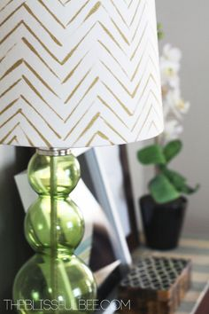 """Going Gold: DIY Chevron Lamp Shade"""" // I love the casual brush stroke used for the line work on this chevron! Painting Lamp Shades, Painting Lamps, Diy Painting, Fabric Lampshade, Lampshades, Painted Lampshade, Gold Lamp Shades, Gold Lamps, Luminaria Diy"""