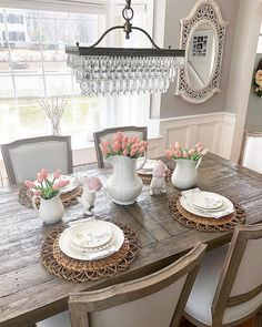 """Better Homes & Gardens on Instagram: """"@the_seasoned_home's table is all dressed up for spring and Easter celebrations! With vases overflowing with tulips, you really don't need…"""" #tulips #easter #tableescapes"""