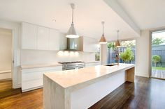 White kitchen with large stove. Bench tops off-white stone, thick. Traditional skirts with not cornice giving a juxtaposition of new and old. All White Kitchen, New Kitchen, Kitchen Ideas, Melbourne House, Storey Homes, Display Homes, House Extensions, New Home Designs, Home Builders