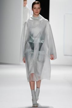 Lacoste Fall 2013 RTW Vogue.com    See-through trench coat.
