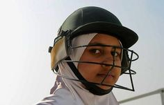 An Afghan girl watches during a cricket game on the school grounds in Kabul on December 28, 2010. Afghanistan is set to select its first ever national women's cricket team in the coming weeks. Women's participation in sport in Afghanistan has increased since the 2001 fall of the hardline Islamist Taliban.