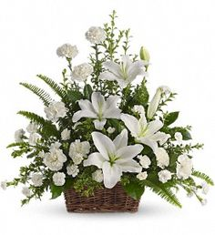 Peaceful White Lilies Basket. Funeral Flowers and Sympathy Flowers - Whether you send this beautiful arrangement to the family home or to the service; all will appreciate its elegance and grace. The contrast of brilliant white blossoms and dazzling greenery create a wonderfully calm and dignified setting. Occasions: Sympathy, Funeral Arrangement Type: Flowers Flower Type: lilies; carnations. Price: $79.95