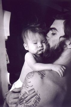 hot guys with tattoos    via weheart it hot guy with beard tattoos holding baby