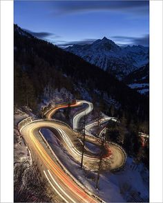 Poster Print-Car lights on the curvy Maloja Pass road at night. Maloja Pass, Engadin, Poster sized print made in the USA Fine Art Prints, Canvas Prints, Framed Prints, Winding Road, Travel Images, Car Lights, Poster Size Prints, Photo Wall Art, Photo Puzzle