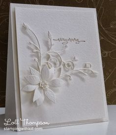 handmade Christmas card from Stamping with Loll ... white on white ... die cut poinsettia and flourish leaves ... gorgous dimension and perfect placement ... a WOW! card ...