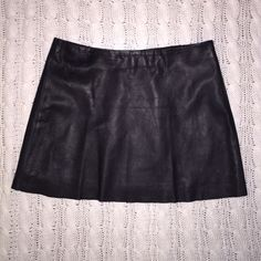 "Leather mini skirt Length is 14"" long. Waist is 30"". Has natural leather marks, one in the middle of the skirt as picture shows. Is lined. Tag says Bebe 8, I would really say this is more for a size 4-6 based on length and waist. It depends on where you want to wear it closer to the waist or on hips. bebe Skirts Mini"