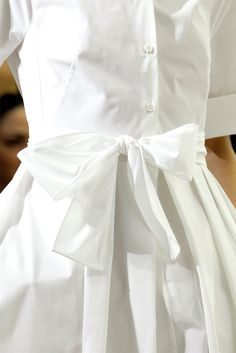 white dress with a bow on the waist