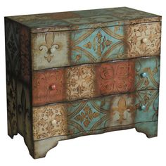 Three-drawer wood chest with medallion and fleur-de-lis detail.   Product: ChestConstruction Material: Wood