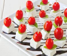 Mini caprese salad bites---LOVE caprese salad---this looks like a perfect way to make it a party appetizer!