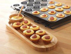 MINI CORN DOG BITES Mix up an 8.5oz box of corn muffin mix, divide batter into the Mini-Muffin Pan, and add hot dog slices. Bake for 10-12 minutes at 375°.