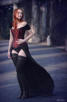 Pretty Goth lady, corset leggings, colored hair.