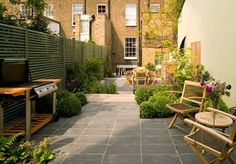 Nice paving with areas of shrub and seating. Contrast green and grey.