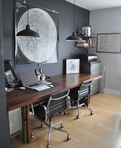 Your at-home office can be as stylish as the rest of your house. An A-typical desk and lighting makes for a welcoming work space.