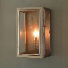 These wall lights really do look the part Having a pressed steel zinc coated frame with four glass panels there is more than a hint of the raw  industrial look about them. When lit however, especially when using a dimmer they give off a beautifully warm light.