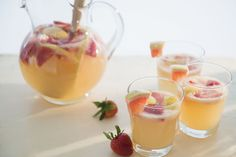 A white wine sangria recipe, this is the perfect party punch for summer. Featuring strawberries, a peach, and lemonade, your guests will love it.
