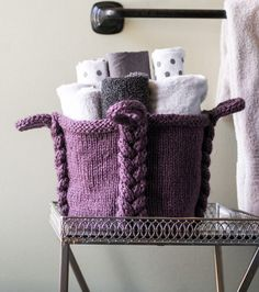 Knitting Pattern for Entangle Basket - The braided detail and handles are knit as the basket is made. Quick knit in super bulky yarn. 8″ high x 26″ around