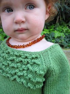 Nola Jane free baby sweater pattern by Annika Barranti with very quick video for how to do the crochet ruffles- even I think I can do this and I don't crochet