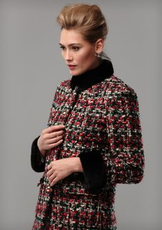 RED AND BLACK TWEED COAT A chunky tweed coat in red, black and white. Fur collar and cuffs are optional, and can come detachable. Gold toned metal button fastening and patch pockets.