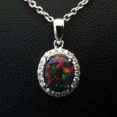 100% Australian black opal and diamond pendant. Gorgeous black opal!