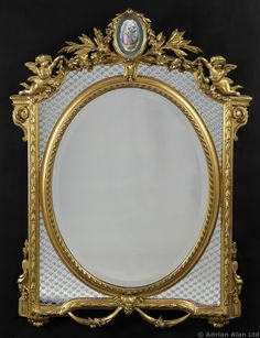 A Fine Louis XVI Style Carved Giltwood Mirror With A Sèvres Style Porcelain Plaque. French, Circa 1890.