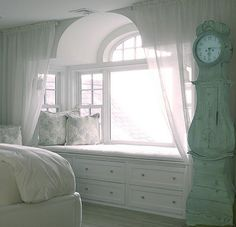 Modern comfort with an old fashioned clock just to add enough character to the room - charming~