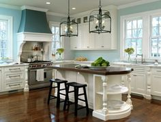 Kitchen - the contrast paint color on the vent hood and architectural details