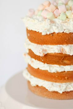 Ambrosia Cake -- marshmallows, cool whip, coconut, mandarin oranges and pineapple...so yummy and refreshing and perfect for Easter!!