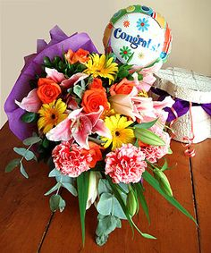Festive Felicitations  Festivities, gratefulness and heartfelt cheers in this endearing bouquet of all our favorite blooms: stargazer lilies, colorful gerberra daisies, bright carnations and roses