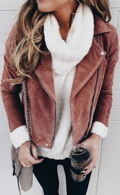 Rose suede jacket over cozy white sweater with black jeans.