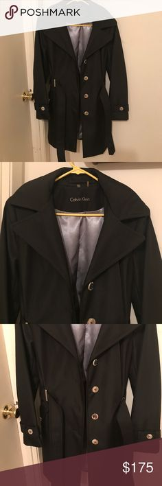 NWOT Calvin Klein long black trench coat sz med Gorgeous long black Calvin Klein waterproof trench coat. 100% polyester.  Buttons are all silver colored as is lining. Never worn. Calvin Klein Jackets & Coats Trench Coats
