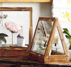 Hand-crafted brass latches secure the glass windows on these A-Frame terrarium…