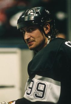 The Los Angeles Kings captain Wayne Gretzky sits on a bench during a game against the New Jersey Devils at the Meadowlands Arena circa the Kings Hockey, Ice Hockey, Hockey Mom, Hockey Pictures, Hockey World, Wayne Gretzky, Pittsburgh Penguins Hockey, New Jersey Devils, Los Angeles Kings