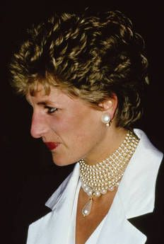 Diana wearing pearls in the style of Queen Mary after her separation from Charles, in November 1993. By choosing to wear her pearls in the style of Queen Mary, she is asserting that she is still royal despite the separation from the Prince of Wales. She was attending a gala performance at Her Majesty's theater, London.